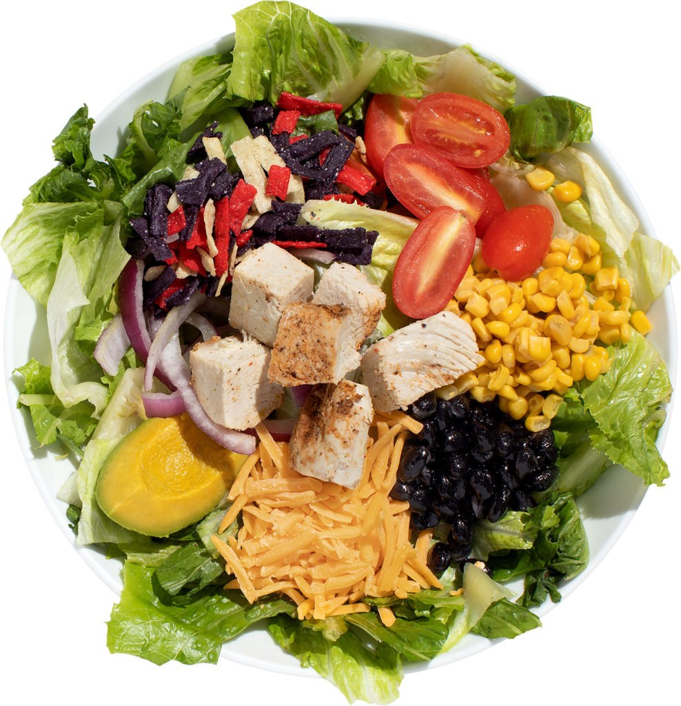 Chicken, corn, black beans, cheddar, and tomatoes salad
